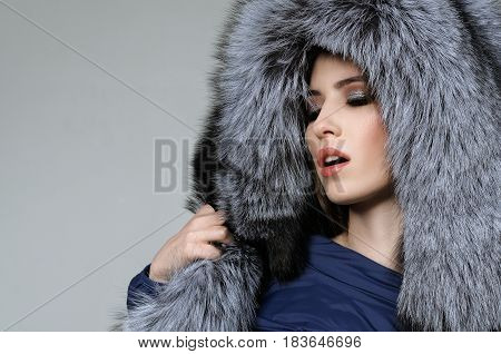 Girl Languidly Takes Off Her Fur Hat