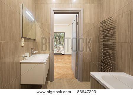 Interior of new modern bright spa bathroom