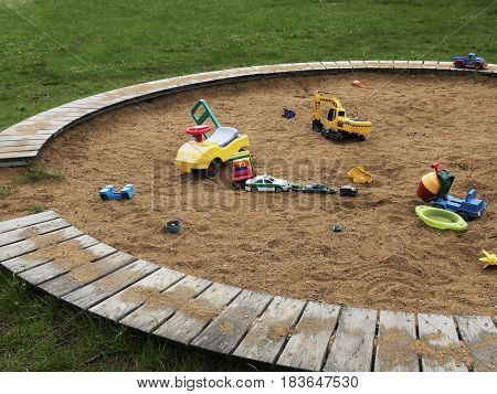 Children's playground with sandbox and toys. Relaxation park, leisure place for families and children. Daily picture without characters.