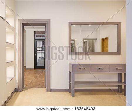Interior of new modern corridor with a mirror