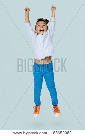 Little Boy Jumping Enjoy Happiness Cheerful Studio Portrait