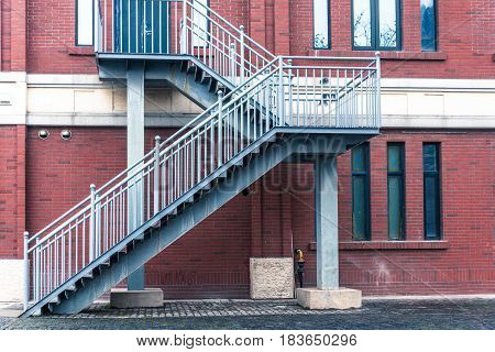 metal staircase against a wall of apartment shot in Shanghai China.