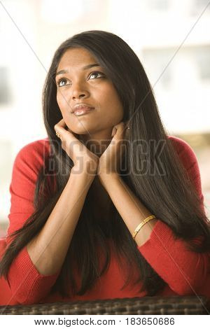 Mixed race woman day dreaming
