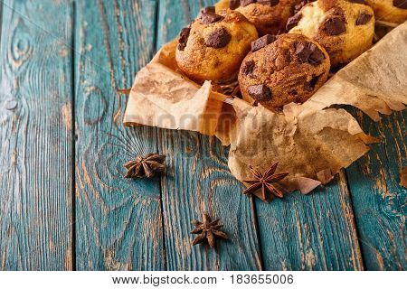 muffins with chocolate on a wooden green background