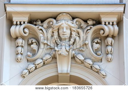 ZAGREB, CROATIA - JULY 17: Architectural detail with a mascaron of a young woman set on top of a column on the facade of an old building, Zagreb, Croatia on July 17, 2014.