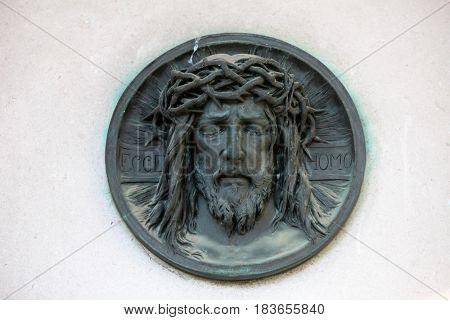 ZAGREB, CROATIA - OCTOBER 28: Ecce homo, Dead Christ - bronze medallion on Mirogoj cemetery in Zagreb, Croatia on October 28, 2013.
