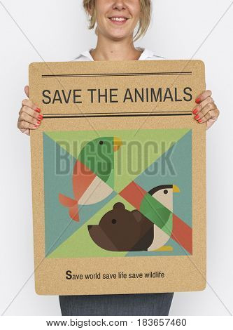 Adult person holding a save the animals banner