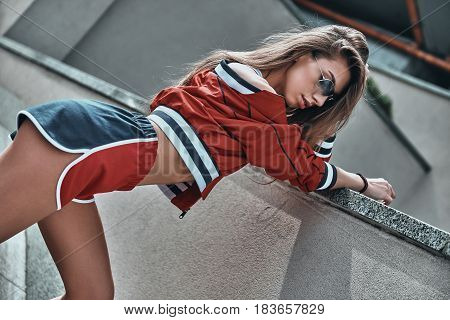 Making sport look good. Attractive young woman in sport clothing posing while standing outdoors