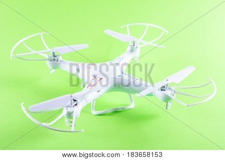 Photo Of White Quadrocopter On Bright Green Background