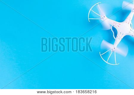 Photo Of White Quadrocopter On Bright Blue Background