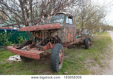 Abandoned rusty Old Truck with a red tinge