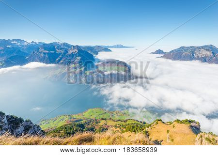 Recreation idyll in the heart of Central Switzerland high above Lake Lucerne. Aerial photography. A view of the clouds from above above the clouds. A sunny autumn day with fog and bright foliage.
