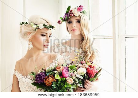 Beautiful Bride Woman with Colorful Flower Arrangement Flower Wreath Bridal Hairstyle and Makeup