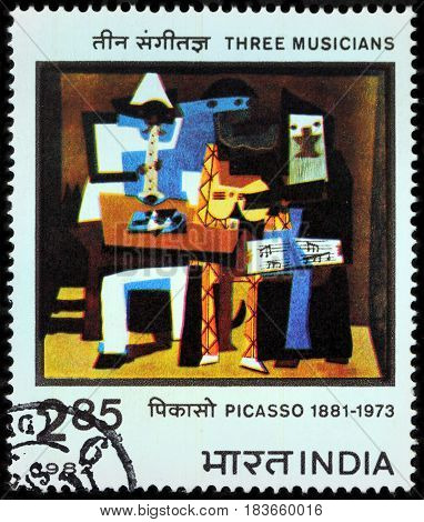 LUGA RUSSIA - APRIL 26 2017: A stamp printed by INDIA shows painting Three Musicians by famous Spanish painter Pablo Picasso circa 1982