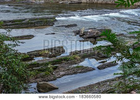 Stream Flowing Through Rocks in forest,china .