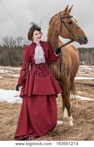 Young woman in vintage stylized suit with Russian Don horse