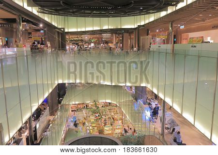 TAIPEI TAIWAN - DECEMBER 5, 2016: Unidentified people visit Q Square. Q Square is a contemporary shopping mall located able the Taipei bus terminal.