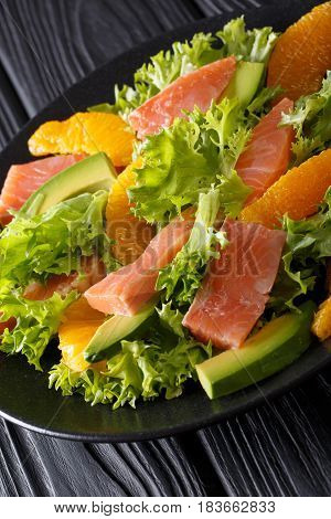 Salad Of Salmon, Oranges, Avocado And Frisee Close-up On A Plate. Vertical