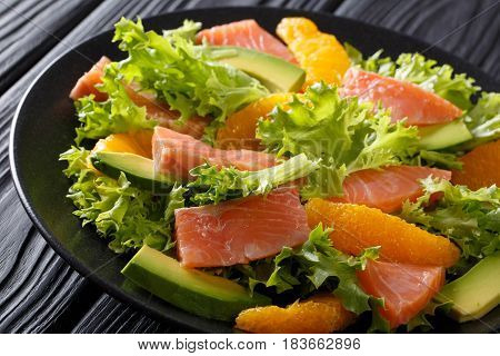 Delicious Salad Of Salted Salmon, Oranges, Avocado And Frisee Close-up. Horizontal