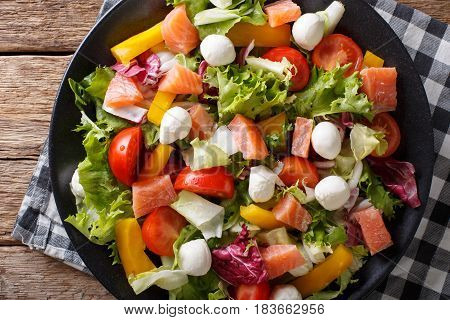 Hearty Salad With Salmon, Mozzarella And Fresh Vegetables Close-up On A Plate. Horizontal Top View