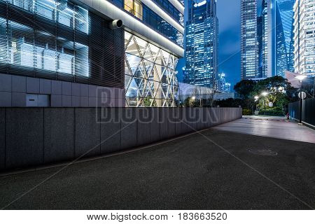 empty space front of modern business architecture at night in city of China.