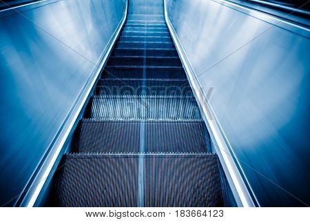 detail shot of escalator in modern buildings or subway stationblue tone.