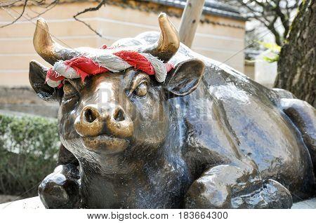 Fukuoka Japan -December 16 2009: The statue of the holy ox at Dazaifu Tenmangu entrance