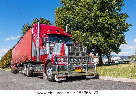 Vivid Red Semi Truck Parked In Rural Town, Australia