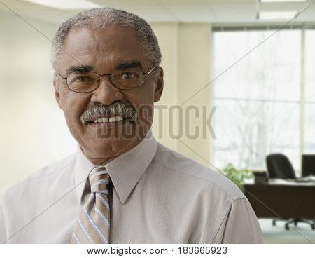 African businessman in office