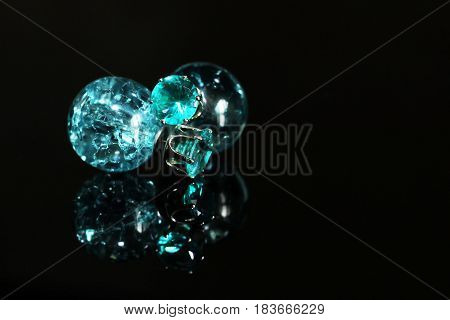 Beautiful Earrings On A Black Background