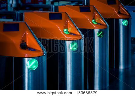 Row of ticket machines in railway station.