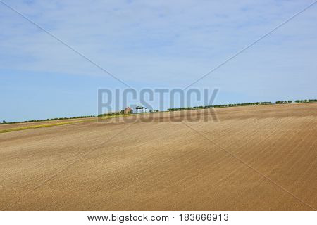 Derelict Farm And Cultivated Soil