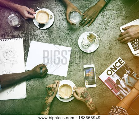 Group of designer sharing ideas and having coffee