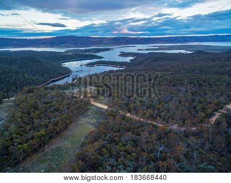 Aerial View Of Snowy River Flowing Into Lake Jindabyne At Sunset. New South Wales, Australia