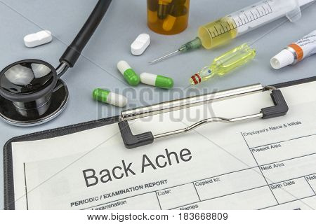 Back Ache medicines and syringes as concept of ordinary treatment health