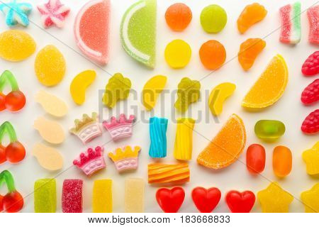 Composition of colorful jelly candies on white background