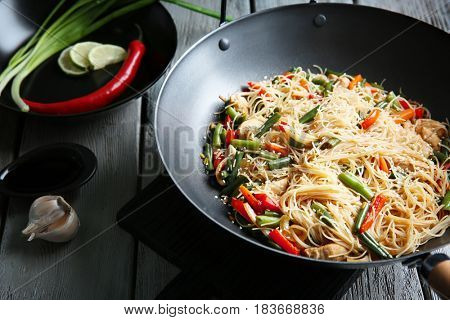 Delicious rice noodle with vegetables on wooden table