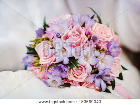 fresh and beautiful colorful wedding bouquet outdoors