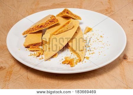 Caramel Honeycomb On A White Plate 02