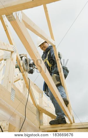 Hispanic construction worker building house