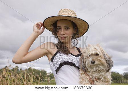 Hispanic woman holding dog