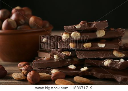 Chopped chocolate bars with nuts, closeup