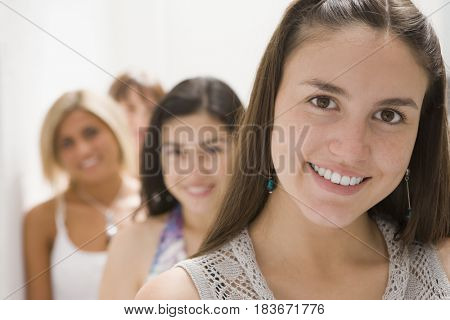 Hispanic woman and friends smiling