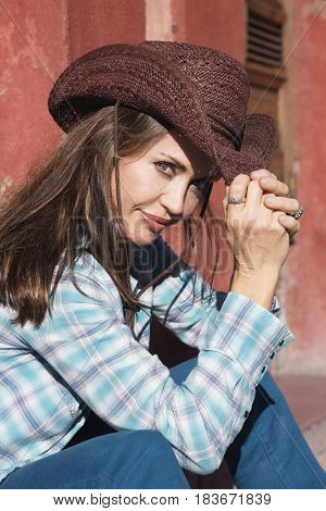 Hispanic woman wearing cowboy hat