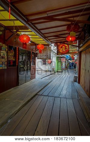 George Town, Malaysia - March 10, 2017: Clan Jetties are unique Chinese settlements existing since the 19th century, along these wooden pier are villages that house the descendants of Chinese immigrants
