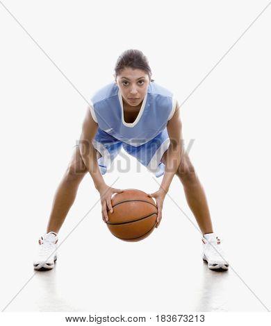 Mixed race woman playing basketball