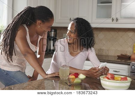 African American sisters in kitchen