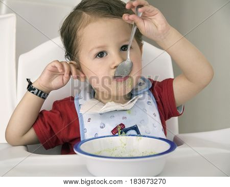 Hispanic boy eating cereal
