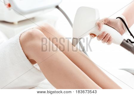 Close-up Partial View Of Young Slim Woman Receiving Laser Skin Care On Leg