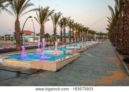 Ashkelon seaside park fountains colored evening light